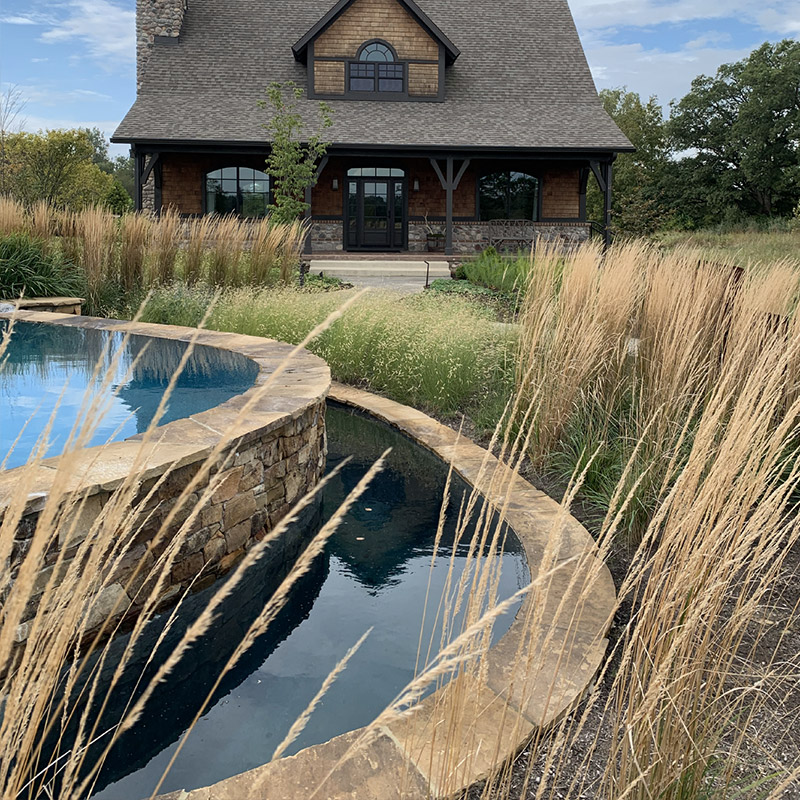 Swimming pool, retaining wall with landscape architecture